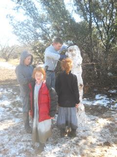 Neighbor Children Building a Snowman